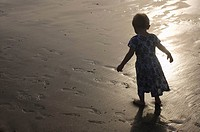 2 year old girl walking at the beach