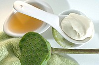 Green tea in a spoon and vanishing cream