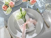 Place setting decorated with eustoma and a white napkin
