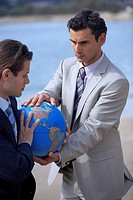 Businessmen hands grasping the globe (thumbnail)