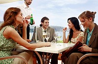 Office workers having drinks in outdoor cafe (thumbnail)