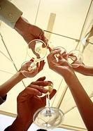 Hands with champagne glasses toasting (thumbnail)
