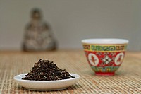 Chinese teacup and plate of tea leaves, still life