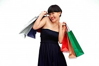 Young woman in black dress with shopping bags