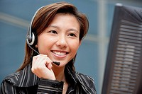 Female executive with hands free device