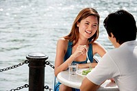 Couple sitting at outdoor cafe, having lunch