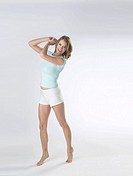 Woman wearing white shorts and a t-shirt poses