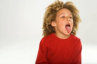 Close-up of a boy sticking his tongue out
