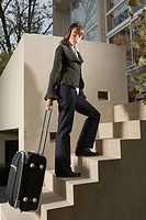 Businesswoman on the move with luggage
