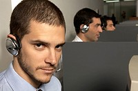 Portrait of a businessman wearing a headset (thumbnail)