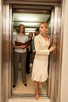 Four business executives in an elevator (thumbnail)