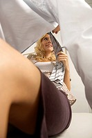 Side profile of a businessman and a businesswoman flirting in an office (thumbnail)