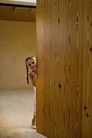 Portrait of young girl in doorway