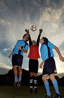 Low angle view of soccer players playing soccer