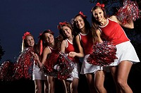 Portrait of cheerleaders dancing and smiling