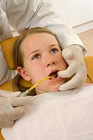 Dentist examining a girl's teeth (thumbnail)