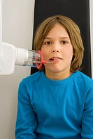 Portrait of a boy undergoing dental treatment