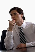Close-up of a businessman sitting at a desk and thinking (thumbnail)