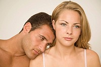Close-up of a young man romancing with a young woman (thumbnail)