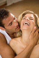Close-up of a young man embracing a young woman (thumbnail)