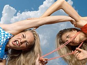 Low angle view of two young women fighting (thumbnail)