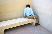 Man sitting on a concrete bench