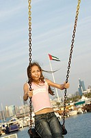 Happy Girl on a swing in Dubai, United Arab Emirates