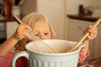 Girl 4-5 baking in kitchen, close-up