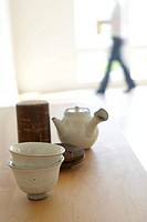 Japanese teapot and teacups on wooden table