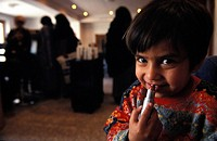 The daughter of Nazira is playing with a lipstick in the Kabul Beauty School