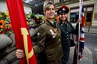 Berlin, a Russian and a British soldier posing at checkpoint Charlie in the Friedrichstrasse