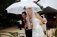Olhuveli Resort, Adrian Godwin from England and Elvira Andreeva from Russian running from the rain during a mock wedding ceremony By law is forbidden ...