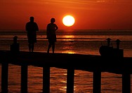 Maldives, couple walking in the twilight