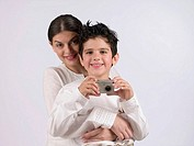 Mother with son holding a camera