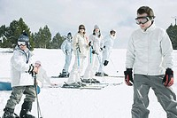 Group of young skiers standing on snow