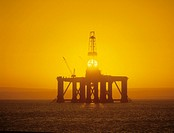 Oil rig at sea, sunrise