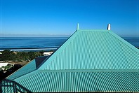 Reunion, roof of a house on seashore