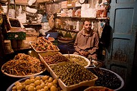 Olive seller in the market at the medina (old town). Essaouira, Morocco.