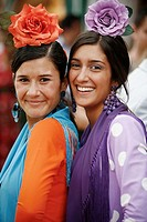Portrait of two women wearing traditional flamenco dress during the April Fair, Seville, Spain