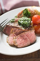 Beef steak with herb butter and accompaniments