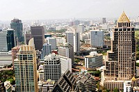 Elevated View of Modern Buildings of Bangrak District and Lumphini Park looking North West, Bangkok. Thailand