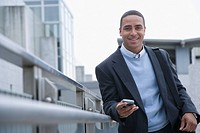 Portrait of man using mobile phone outdoors