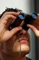 man, binoculars