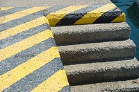 Stairs at port with warning yellow marks