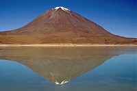 View of the Snowcapped Volcano Licancabur and its Reflection  Altiplano, Bolivia