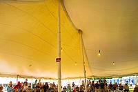 Interior of a large fair tent.