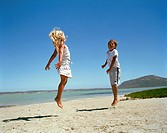 Young Boy and Girl on the Beach, Jumping  Cape Town, Western Cape Province, South Africa