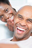 Portrait of an African Couple - Woman Whispering into Man´s Ear  Cape Town, Western Cape