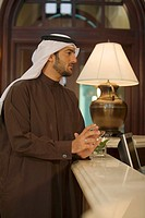 Arab Businessman Listening to information at Reception Area  Dubai, United Arab Emirates