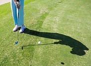 Woman Hitting Golf Ball onto Green  Clovelly Golf Course, Cape Town, Western Province, South Africa